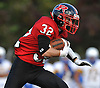 Plainedge running back No. 32 Jake Esposito carries upfield during the third quarter of a Nassau County Conference III varsity football game against Lawrence at Plainedge High School on Saturday, October 17, 2015. Plainedge won 38-0.<br /> <br /> James Escher