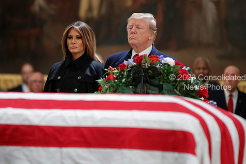 US President Donald J. Trump and First Lady Melania Trump take a moment of silence at the casket containing the body of former US President George H.W. Bush in Rotunda of the US Capitol in Washington, DC, USA, 03 December 2018. Bush, the 41st President of the United States (1989-1993), died in his Houston, Texas, USA, home surrounded by family and friends on 03 November 2018. The body will Lie in State in the Capitol before being moved to the Washington National Cathedral for a funeral service. It will then return to Houston for another funeral service before being transported by train to the George Bush Presidential Library and Museum for internment.