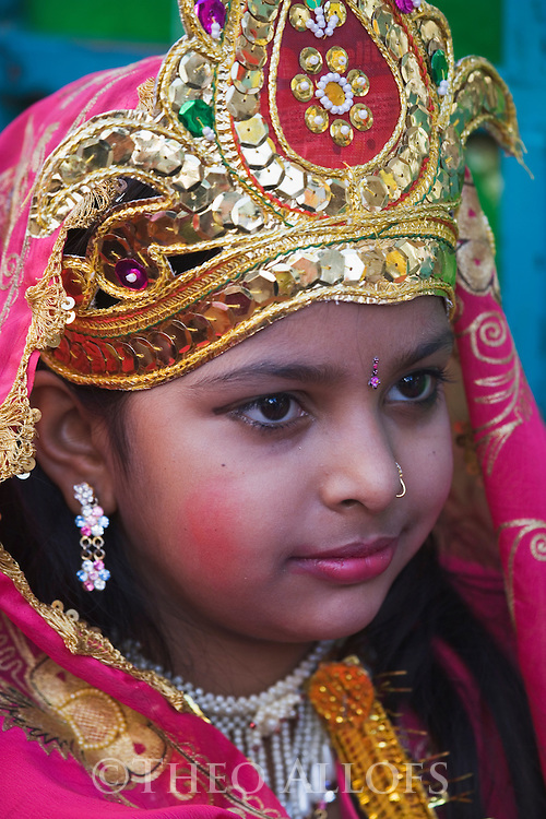 A dressed up girl during a holy procession in Pushkar; Pushkar is one of the five sacred pilgrimage sites for devout Hindus, Pushkar, Rajasthan, India --- Model Released