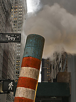Steam is directed upwards at a NYC construction site.