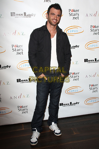 "TONY DOVOLANI. Lupus LA Raises Awareness with ""Get Lucky for Lupus"" held At Andaz Hotel, West Hollywood, California, USA..February 25th, 2010.full length black jacket jeans denim hands in pockets .CAP/ADM/KB.©Kevan Brooks/AdMedia/Capital Pictures."