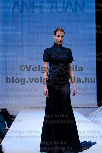 Model presents a creation by Hungarian fashion designer Luu Anh Tuan originally from Vietnam during the Budapest Looks winter luxury fashion show in Budapest, Hungary on December 02, 2011. ATTILA VOLGYI
