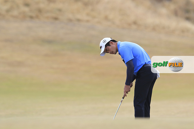 Wen-chong LIANG (CHN) putts on the 1st green during Thursday's Round 1 of the 2015 U.S. Open 115th National Championship held at Chambers Bay, Seattle, Washington, USA. 6/18/2015.<br /> Picture: Golffile | Eoin Clarke<br /> <br /> <br /> <br /> <br /> All photo usage must carry mandatory copyright credit (&copy; Golffile | Eoin Clarke)