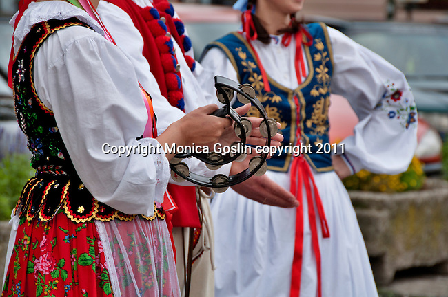 A group of musicians and dancers in traditional costumes in Krakow, Poland