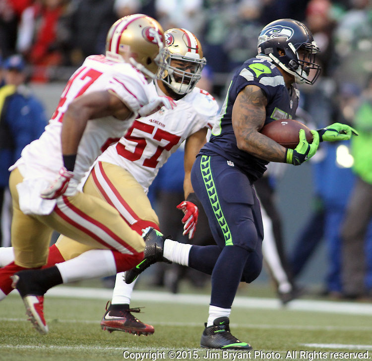 Seattle Seahawks running back Thomas Rawls (34) runs past Francisco 49ers linebacker Michael Wilhoite (57) and defensive back Marcus Cromartie (47) on his way to a 31-yard touchdown at CenturyLink Field in Seattle, Washington on November 22, 2015.  The Seahawks beat the 49ers 29-13.   ©2015. Jim Bryant Photo. All RIghts Reserved.