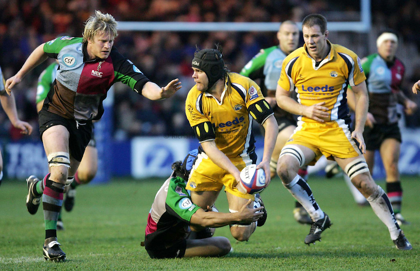Photo: Frances Leader..NEC Harlequins v Leeds Tykes. Zurich Premiership. .28/11/2004..Leeds Scott Morgan is pulled down by Harlequins' Roy Winters...