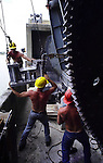 A construction crew with Sieg & Ambachtsheer Inc. works to swing a refurbished portion of the gear mechanism for the Main Street Bridge draw span into place, Thursday, July 12, 2001.  (Brian Myrick)