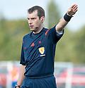 Referee Alan Muir.