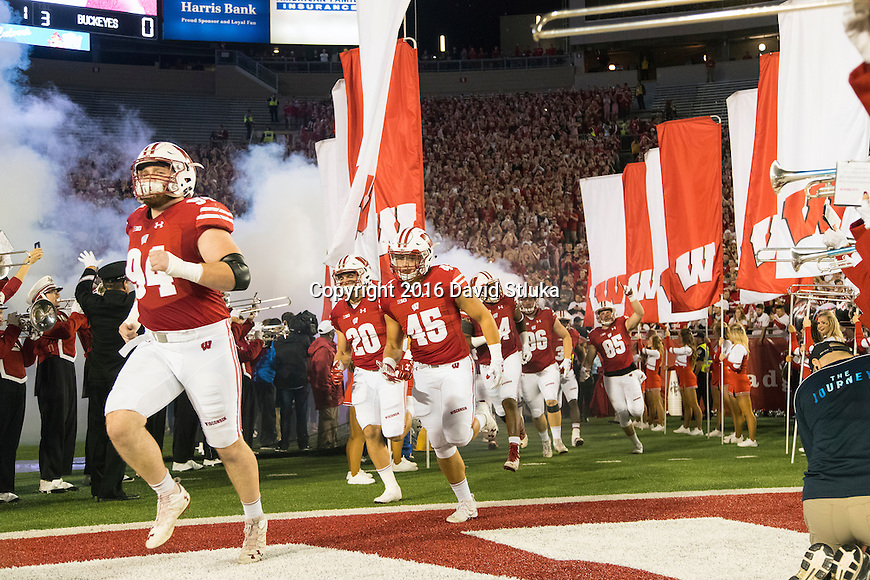 Wisconsin Badgers run onto the field prior to an NCAA Big Ten Conference college football game against the Ohio State Buckeyes Saturday, October 15, 2016, in Madison, Wis. The Buckeyes won 30-23 in overtime. (Photo by David Stluka)