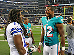 Dallas Cowboys wide receiver Dwayne Harris (17) and Miami Dolphins running back Charles Clay (42) in action during the pre- season game between the Miami Dolphins and the Dallas Cowboys at the Cowboys Stadium in Arlington, Texas. Dallas defeats Miami 30 to 13...