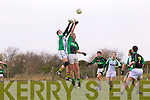 Declan Doody of Na Gaeil and Michael Corrigan of Granagh/Ballingarry contest the ball in the Muster Junior B Football Final last Sunday afternoon in Knockaderry.