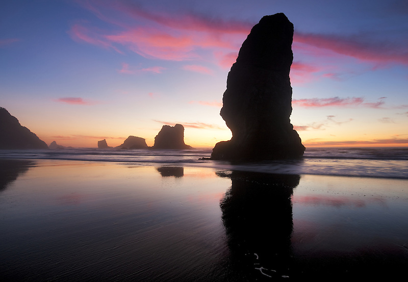 Low tide and sunset reflection at Samuel H. Boardman State Scenic Corridor. Oregon