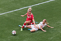 June 21, 2015: Lauren SESSELMANN of Canada and Lara DICKENMANN of Switzerland compete for the ballduring a round of 16 match between Canada and Switzerland at the FIFA Women's World Cup Canada 2015 at BC Place Stadium on 21 June 2015 in Vancouver, Canada. Canada won 1-0. Sydney Low/Asteriskimages.com