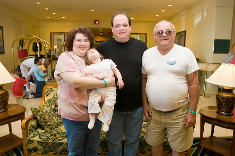 The Decker family at the Share and Care Network's annual retreat held at the Doubletree Guest Suites Hotel in Boston on May 20, 2006. <br /> <br /> The Share and Care Network was created in 1981 by Pat Cahill when her son Scott was diagnosed with Cockayne Syndrome.  A rare form of dwarfism, Cockayne Syndrome is a genetically determined condition whose symptoms include microcephaly, mental retardation, progressive blindness, progressive hearing loss, premature aging, and a shortened lifespan averaging 18 years.  Those afflicted have distinctive facial features, including sunken eyes, pinched faces, and protruding jaws as well as distinctive gregarious, affectionate personalities.<br /> <br /> Because of the rarity of the condition (1/1,000 live births) and its late onset (characteristics usually begin to appear only after one year), many families and physicians are often baffled by children whose health begins to deteriorate after normal development.  It was partly with this in mind that the Share and Care Network was formed, to promote awareness of this disease as well as to provide a support network for those families affected.  In 1998 it began organizing an annual retreat, which has grown from three families in its inaugural year to more than 30 today.  Although the retreat takes place in the United States, families from as far as Japan arrive for this one weekend out of the year to share information and to support one another.