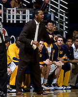 California assistant coach Travis DeCuire talks with his players during the game against UCSB Gauchos at Haas Pavilion in Berkeley, California on December 19th, 2011.   California defeated UC Santa Barbara, 7-50.
