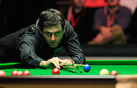 Ronnie O'Sullivan uses a rest to aid his shot during the Dafabet Masters FINAL between Barry Hawkins and Ronnie O'Sullivan at Alexandra Palace, London, England on 17 January 2016. Photo by Liam Smith / PRiME Media Images