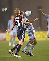 New England Revolution defender Pat Phelan (28) pressures Colorado Rapids midfielder Nick LaBrocca (22) as he controls the ball. The New England Revolution tied the Colorado Rapids, 1-1, at Gillette Stadium on May 16, 2009.