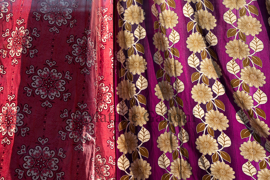 India - Manipur - Imphal - A curtain separating the Ima Market from the street helps protect the goods and the vendors from the sun.