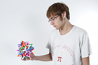 OrigamiUSA 2016 Convention at St. John's University, Queens, New York, USA. Aaron Pfitzenmaier, San Antonio, Texas. A Convention Pro, also a creator of original origami designs and models.