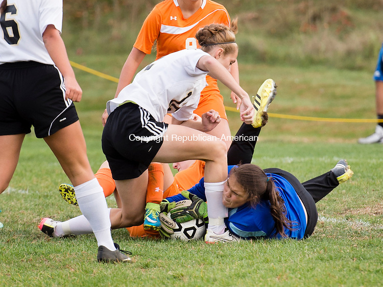 BEACON FALLS, CT- 22 October 2015-102215EC04-  Woodland's Megen Sirowich falls over Watertown's goalkeeper, Emily Hill, as the Hawks try to score Thursday in Beacon Falls. Erin Covey Republican-American