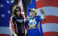 Sept. 6, 2010; Clermont, IN, USA; NHRA funny car driver Melanie Troxel (left) jokes with Ron Capps during driver introductions prior to the U.S. Nationals at O'Reilly Raceway Park at Indianapolis. Mandatory Credit: Mark J. Rebilas-