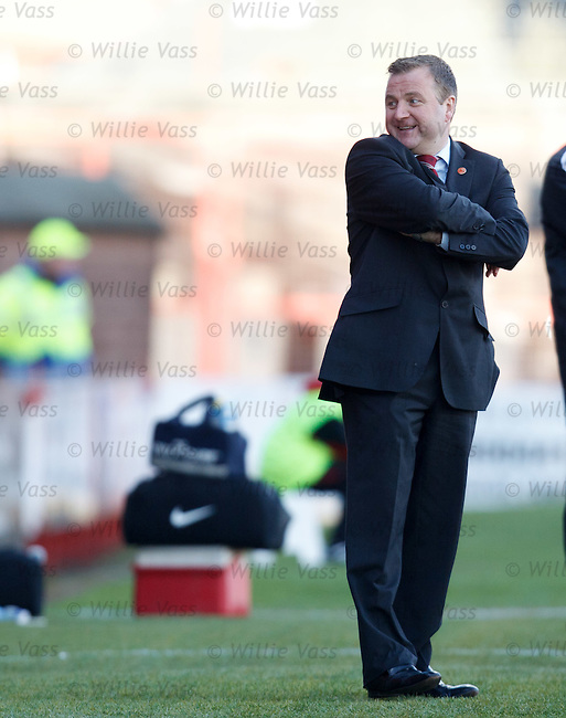 Billy Reid turns to his bench and laughs as Hamilton take the lead