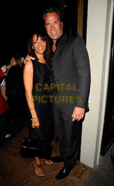 "ALISON & DAVID SEAMAN.At the ""Chicago"" Musical new cast change Press Night, .Cambridge Theatre, London, .England, June 2nd 2008..full length black dress grey suit husband wife.CAP/CAN.©Can Nguyen/Capital Pictures"