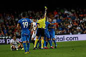 17th March 2019, Mestalla Stadium, Valencia, Spain; La Liga football, Valencia versus Getafe; Sanchez Martinez shows a yellow card to Francisco Portillo of Getafe