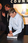 Microsoft Chairman and Chief Software Architect Bill Gates signs a Gateway 3450 laptop at the launch celebration of Windows XP at the Gateway Country Store October 24, 2001 in New York. Windows XP is the latest operating system from  Microsoft. (Photo by Lawrence Lucier)