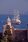 Croatia, Dubrovnik, Cruise ship, Sail assisted cruise ship stands off the old town walls, UNESCO World Heritage Site, Adriatic Sea, Europe,
