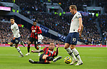 Tottenham's Harry Kane is challenged by Bournemouth's Steve Cook during the Premier League match at the Tottenham Hotspur Stadium, London. Picture date: 30th November 2019. Picture credit should read: Paul Terry/Sportimage
