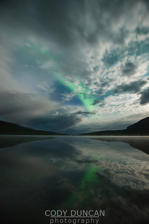 Northern Lights and moonlight over lake Abeskojavri - Abiskojaure, Kungsleden trail, Lapland, Sweden
