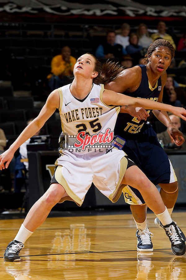 Jaymee Carnes #25 of the Wake Forest Demon Deacons boxes out Alex Montgomery #22 of the Georgia Tech Yellow Jackets at the Lawrence Joel Coliseum on January 13, 2011 in Winston-Salem, North Carolina.  The Yellow Jackets defeated the Demon Deacons 54-46.  Photo by Brian Westerholt / Sports On Film