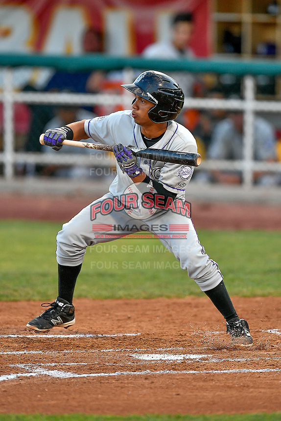 Jose G. Rodriguez (13) of the Grand Junction Rockies squares to bunt against the Orem Owlz in Pioneer League action at Home of the Owlz on July 6, 2016 in Orem, Utah. The Rockies defeated the Owlz 5-4 in Game 2 of the double header.  (Stephen Smith/Four Seam Images)