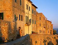 Tuscany, Italy, <br /> Evening sun on Pienza's Via della Cassello set on the hilltown's Renaisance store walls
