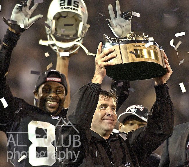 Bill Callahan and Jerry Rice celebrate championship trophy on Sunday, January 19, 2003, in Oakland, California. The Raiders defeated the Titans 41-24 in the conference championship game.