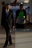 United States President Barack Obama walks with First Lady Michele Obama at the U.S.S. Arizona Memorial on Thursday, December 29, 2011 in Pearl Harbor, Hawaii.  .Credit: Kent Nishimura / Pool via CNP