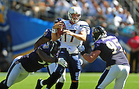 Sep. 20, 2009; San Diego, CA, USA; San Diego Chargers quarterback (17) Phillip Rivers gets sacked in the second quarter by the Baltimore Ravens at Qualcomm Stadium in San Diego. Baltimore defeated San Diego 31-26. Mandatory Credit: Mark J. Rebilas-