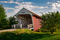 The Imes Bridge is a wooden covered bridge in Madison County, Iowa. Built in 1870, it was originally located over the Middle River. In 1887 it was moved to a spot over Clinton Creek, and in 1977 was moved again to its present site. It is 81 feet  long and is the oldest of the remaining covered bridges in Madison County. It was renovated in 1997 for a cost of $31,807.