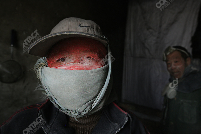 Workers from a limekiln of the Heilonggui Industrial District in Inner Mongolia. March 22, 2007.