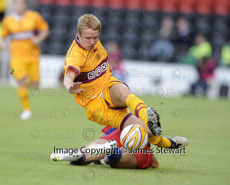 06/08/2009  Copyright  Pic : James Stewart.sct_04_motherwell_v_steaua_bucharest  .PAUL SLANE IS CHALLENGED BY EMIL NINU.James Stewart Photography 19 Carronlea Drive, Falkirk. FK2 8DN      Vat Reg No. 607 6932 25.Telephone      : +44 (0)1324 570291 .Mobile              : +44 (0)7721 416997.E-mail  :  jim@jspa.co.uk.If you require further information then contact Jim Stewart on any of the numbers above.........