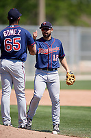 Minnesota Twins Alex Robles (12) greets pitcher Moises Gomez (65) during a Minor League Spring Training game against the Tampa Bay Rays on March 15, 2018 at CenturyLink Sports Complex in Fort Myers, Florida.  (Mike Janes/Four Seam Images)