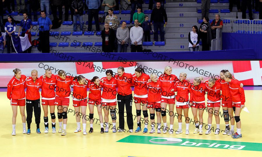 NIS, SERBIA 6/12/2012/ Danmark national handball team players sings national anthem before start of Women`s European Handball Championship EHF EURO 2012 match between Denmark and France in Cair arena in city of Nis in southern Serbia on  December 6, 2012 Credit: PEDJA MILOSAVLJEVIC/SIPA/