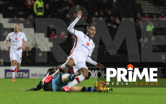 Rob Hall of MK Dons is fouled during the Sky Bet Championship match between MK Dons and Sheff Wednesday at stadium:mk, Milton Keynes, England on 15 December 2015. Photo by Liam Smith.