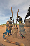 Women grind grain in Matuli, a village in northern Malawi.