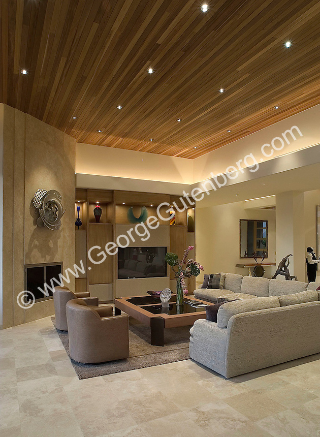 Elegant living room with travertine floor and fireplace