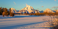 Winter Sunrise  on Mt. Moran viewed from Oxbow Bend on the Snake River in Grand Teton National Park in Wyoming.