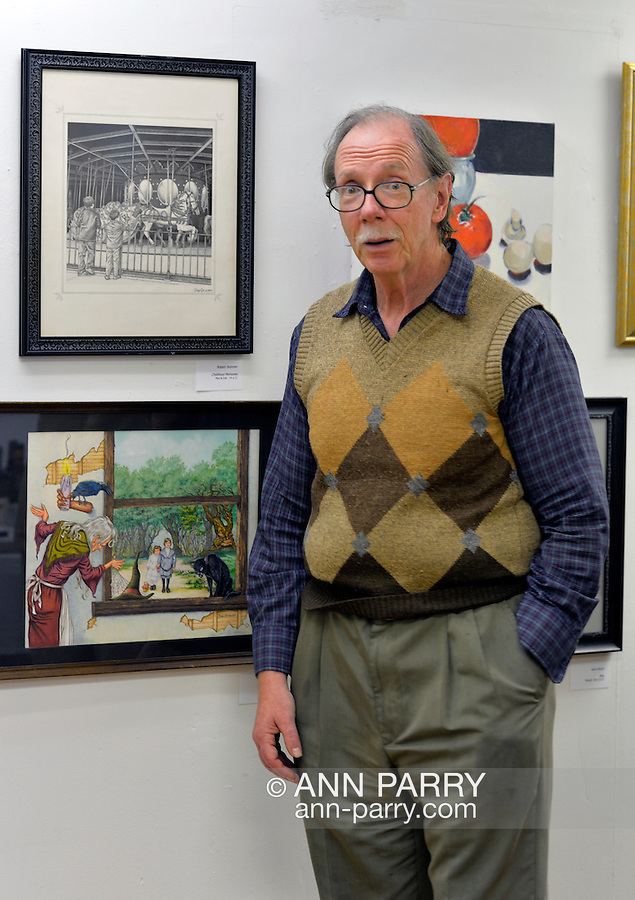 Port Washington, New York, U.S 6th October 2013. ROBERT STUHMER next to his illustrations at The Artists Reception for Members Showcase of the Art Guild of Port Washington, at The Graphic Eye Gallery.