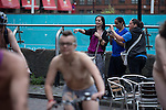 © Joel Goodman - 07973 332324 .  12/06/2015. Manchester, UK. The route of the ride passing through Canal Street in Manchester's Gay Village . Hundreds take part in the World Naked Bike Ride , which sees cyclists undress and cycle nude through Manchester City Centre . Photo credit : Joel Goodman