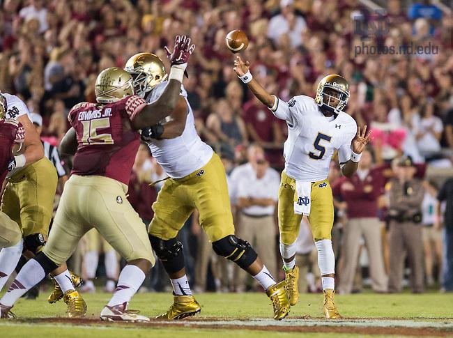 Oct. 18, 2014; Quarterback Everett Golson (5) throws in the first quarter against Florida State. (Photo by Matt Cashore)